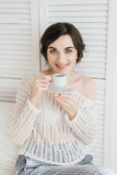 Girl drinking coffee and a croissant in bed. Young beautiful girl drinking coffee and a croissant in bed for Breakfast in the morning Royalty Free Stock Image