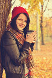 Girl drinking coffee in disposable cup Royalty Free Stock Photos