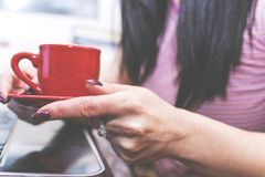 Girl drinking coffee in front of the computer. Interval. royalty free stock image