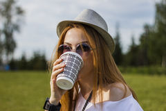 Girl drinking the coffee Stock Photos