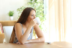 Girl drinking coffee at home royalty free stock photo