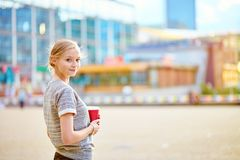 Girl drinking coffee at La Defense in Paris Stock Image