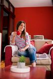 Girl drinking coffee. In living room Royalty Free Stock Photos