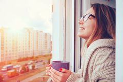 Girl drinking coffee in morning stock photography