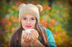 Girl Drinking Coffee in Nature stock photos