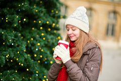 Girl drinking coffee near Christmas tree Stock Image