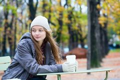 Girl drinking coffee in an outdoor cafe Royalty Free Stock Photo