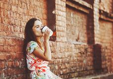 Girl drinking coffee Stock Photos