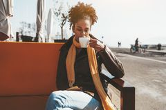 Girl drinking coffee in a street bar stock photo