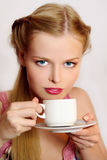 Girl drinking coffee or tea Royalty Free Stock Photos