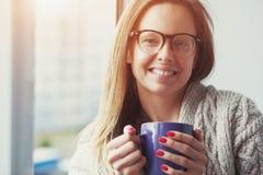 Girl drinking coffee or tea Royalty Free Stock Photos