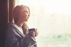 Girl drinking coffee or tea in morning Royalty Free Stock Image