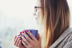 Girl drinking coffee or tea in morning Royalty Free Stock Photography