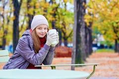 Girl drinking coffee or tea outdoors Stock Photos