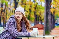 Girl drinking coffee or tea outdoors Stock Photography