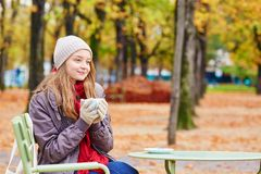 Girl drinking coffee or tea outdoors Royalty Free Stock Image