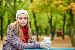 Girl drinking coffee or tea outdoors Royalty Free Stock Photo