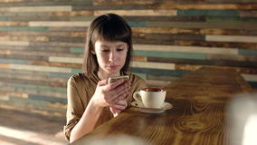 Girl drinking coffee and writing a message stock video footage