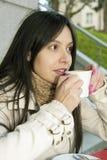 Girl drinking coffee Royalty Free Stock Photos