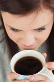 Girl drinking a cup of coffee Royalty Free Stock Image