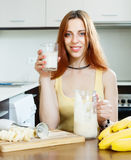 Girl  drinking fresh milk shake with bananas Stock Images