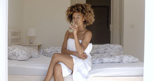 Girl Drinking Fresh Water On The Bed Stock Image