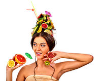 Girl drinking fruit cocktail on summer party. Woman fruits hairstyle. Royalty Free Stock Photo