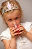 Girl drinking fruit smoothie Royalty Free Stock Images