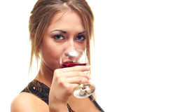 Girl drinking from a glass. Girl isolated on white background drinking from a glass Royalty Free Stock Images