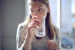 Girl drinking from glass