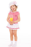 Girl drinking a glass of juice. Stock Photos