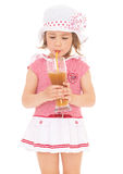 Girl drinking a glass of juice. Royalty Free Stock Image