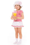 Girl drinking a glass of juice. Royalty Free Stock Photos