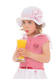 Girl drinking a glass of juice. Royalty Free Stock Images