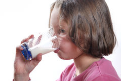 Girl drinking a glass of milk Stock Photography