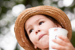 Girl is drinking from a glass on the nature Royalty Free Stock Images