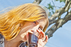 Girl drinking good coffee. Young girl drinking coffee in the morning Royalty Free Stock Images