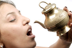 Girl drinking holy water Royalty Free Stock Images