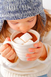 Girl drinking hot chocolate Stock Photo