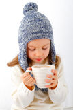 Girl drinking hot chocolate Royalty Free Stock Image