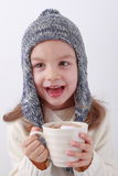 Girl drinking hot chocolate Stock Image