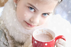 Girl drinking hot chocolate outdoor Royalty Free Stock Photography