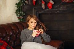 Girl drinking hot Christmas drink Stock Photos