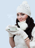 Girl drinking hot coffee Royalty Free Stock Images