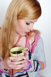 Girl drinking hot coffee or tea Royalty Free Stock Photos