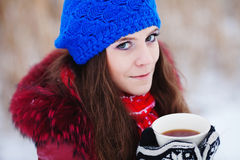 Girl drinking hot tea Royalty Free Stock Photography