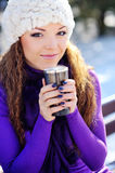 Girl drinking hot tea in the winter forest Stock Photos