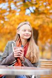 Girl drinking hot wine in a cafe Stock Photo