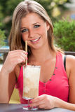 Girl drinking ice coffee outdoor Royalty Free Stock Photo