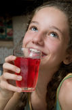 Girl drinking juice Stock Photos